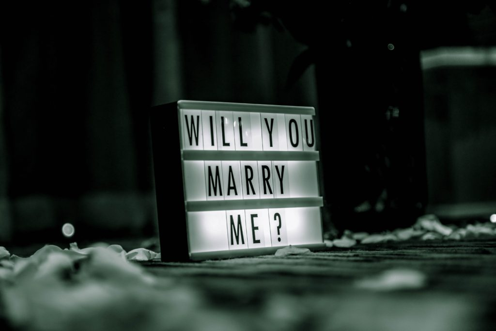 """advertising sign with """"Will You Marry Me"""" on it"""